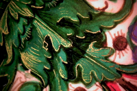 Microscopic image of a leaf face from one of the frame ornaments; highlights are provided by gold paint