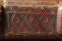 Blind-tooled decoration of the spine field