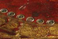 Damage of the board decoration reveals that the double circle ornament is a leather onlay