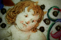 Detail of the putto holding coat-of-arms on a microscopic photo