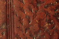 There are peltate leaves, acrons and flower stem motif in the wide, blind-tooled frame