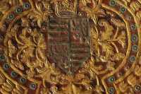 Coat-of-arms and the rich floral motif surrounding it