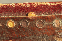 Gilded leather onlay which was detached from the covering and moved from its original place.