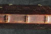 The spine is decorated with a blind-tooled diamond net