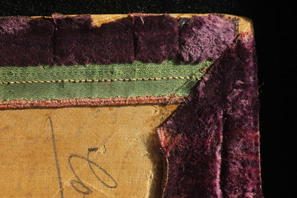 Top corner of the left board, with the turn-in intact edge of the velvet and mitered corner